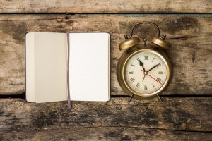 notebook clock wood backgrnd